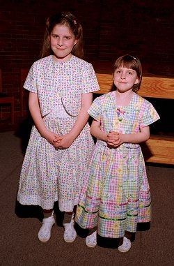Sarah and Emily wearing their new Easter dresses!
